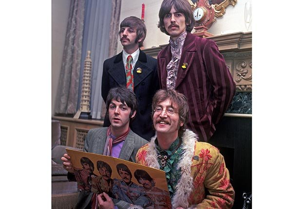 The Beatles at the 1967 launch of Sgt Pepper in their Saville Row offices.