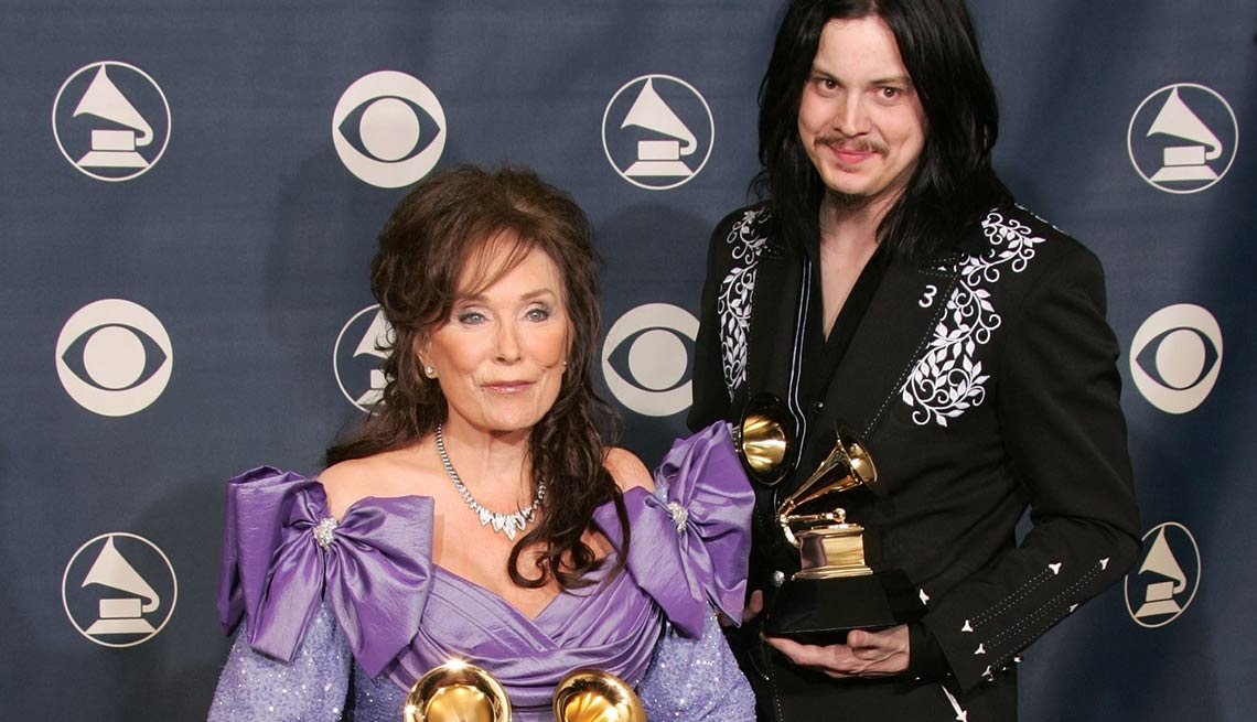 Loretta Lynn and Jack White pose backstage with their awards for 'Best Country Collaboration With Vocals' during the 47th Annual Grammy Awards at the Staples Center February 13, 2005 in Los Angeles, California.