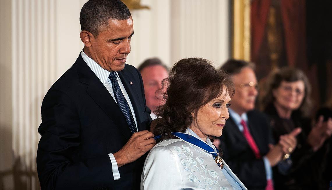 President Barack Obama presents the Presidential Medal of Freedom to country singer Loretta Lynn.