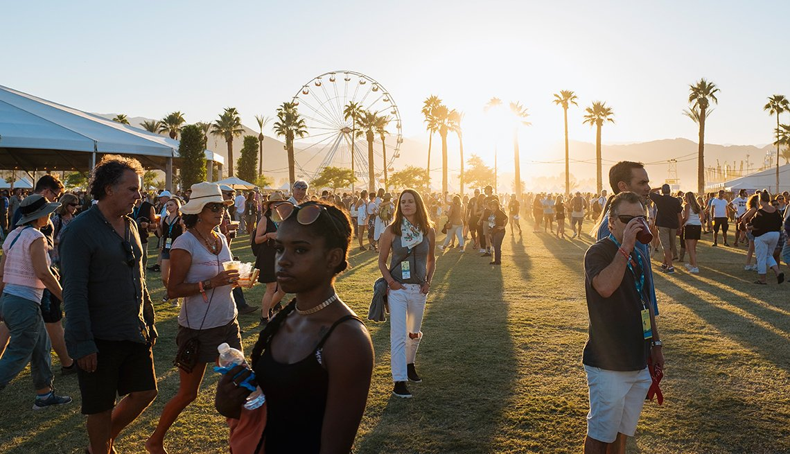 Music fans wander the grounds on the second day of Desert Trip Music Festival