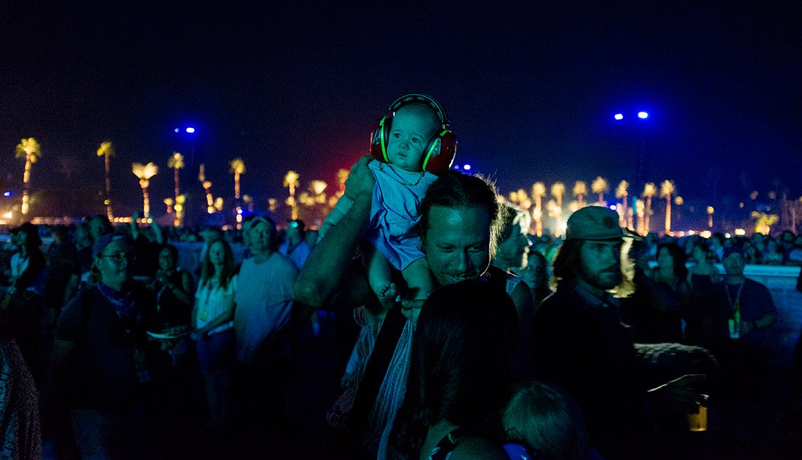 A very young concert attendee takes in the performance of The Who