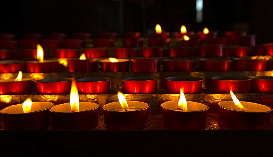 Votive candles in dark church