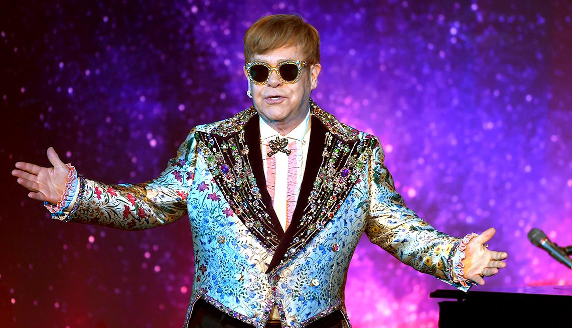 Sir Elton John singing