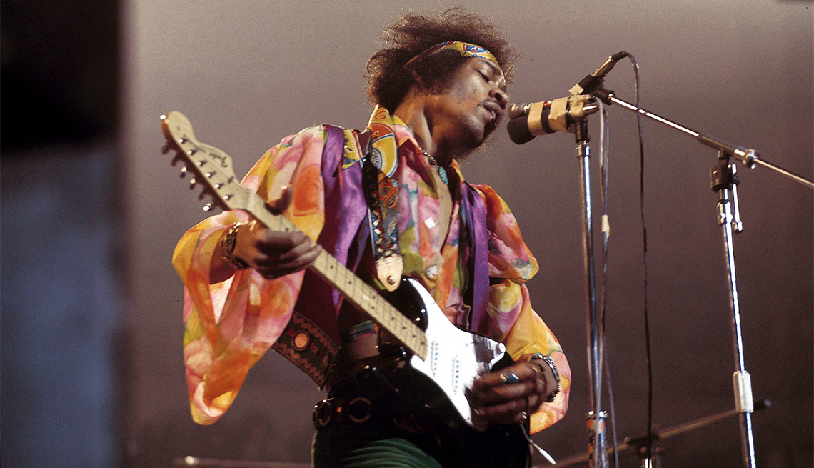 jimi hendrix performing live onstage playing black fender stratocaster guitar. Black Bedroom Furniture Sets. Home Design Ideas