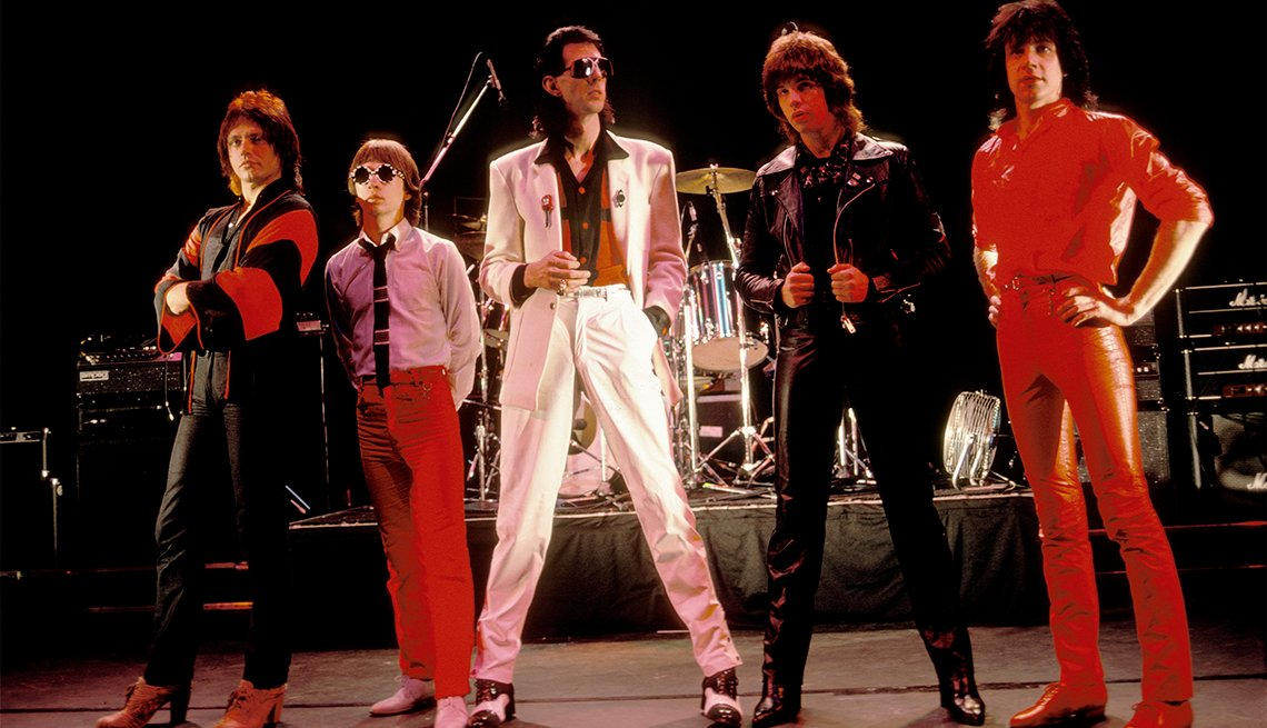 The five members of the rock band Cars on stage