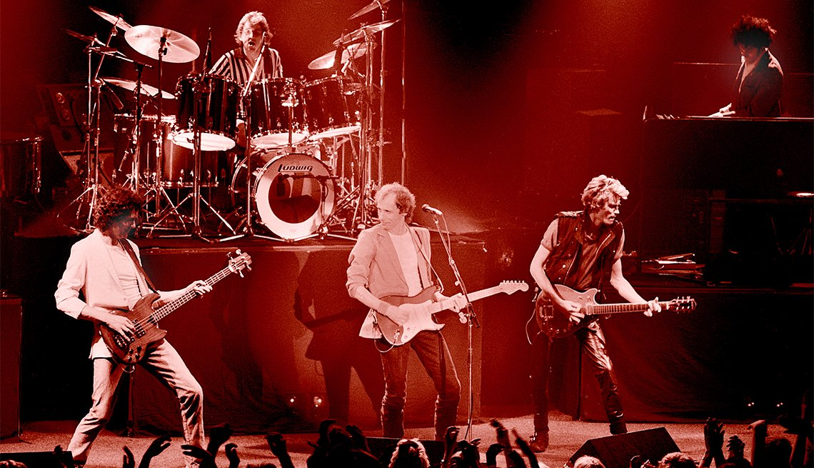 Dire Straits perform on stage in Guildford, 1982.