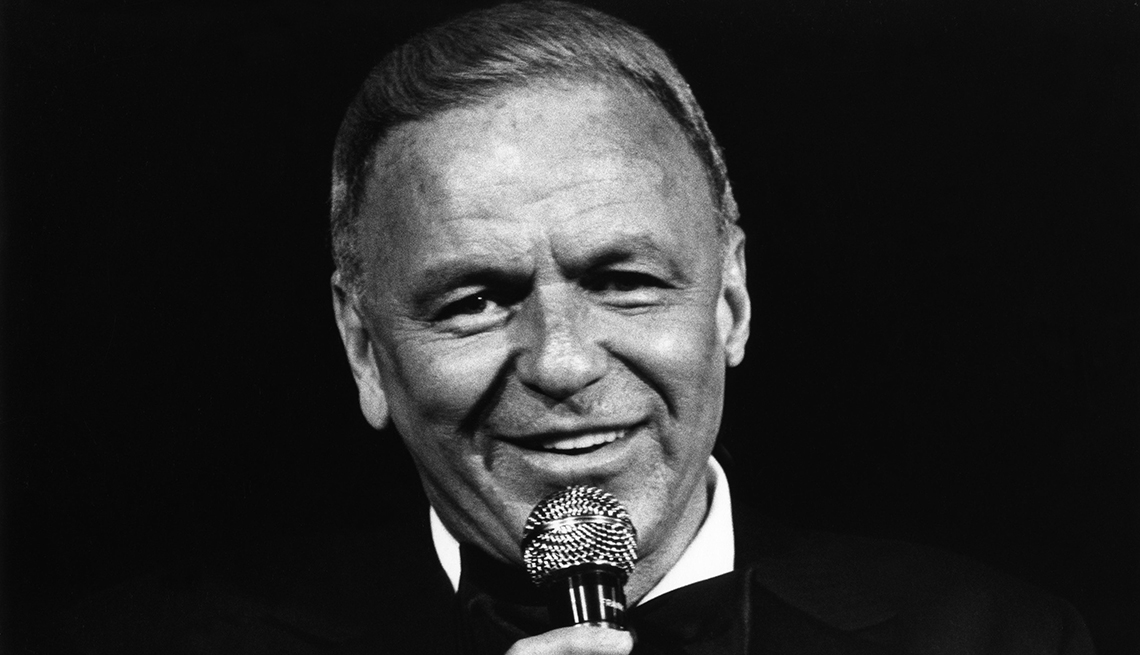 Frank Sinatra with a microphone.