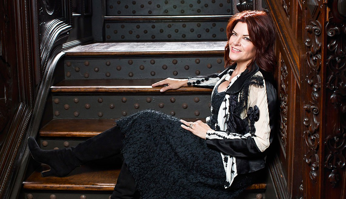 Rosanne Cash, sitting on stairs