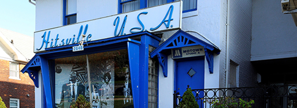 Hitsville U.S.A. building, with Hitsville U.S.A. in blue font on front of building.