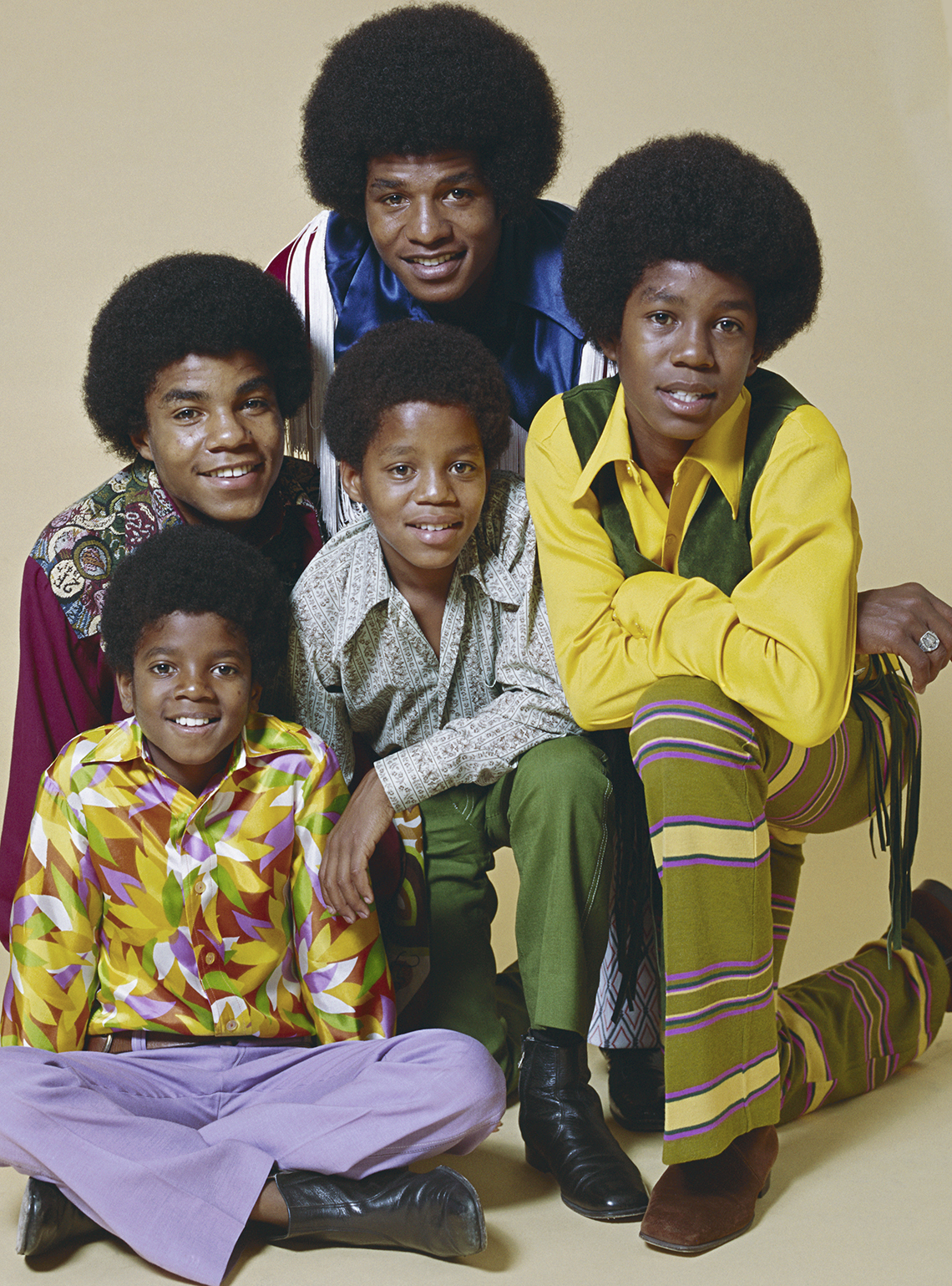 The Jackson Five pose for a photo.