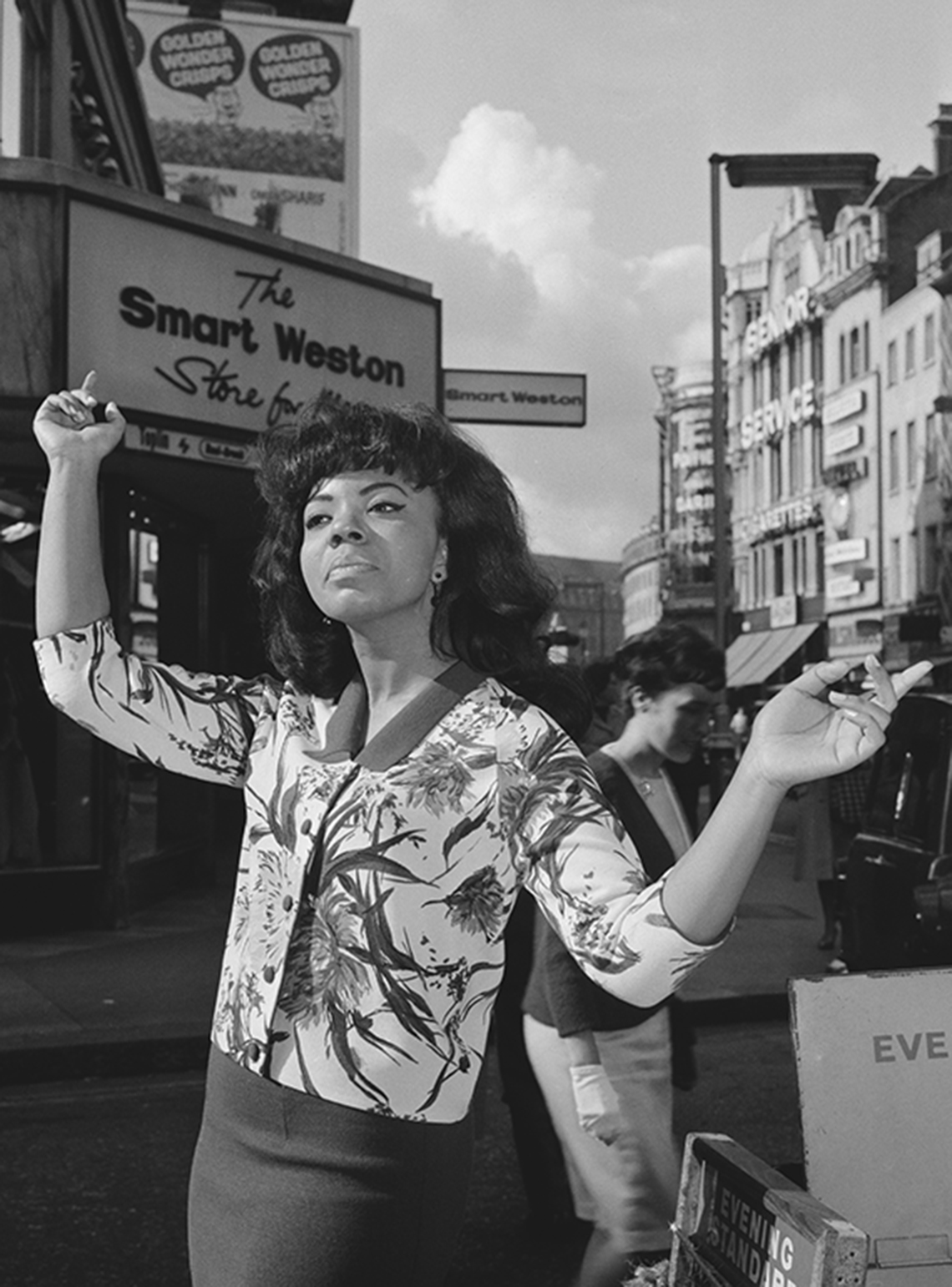 Mary Wells standing on a London street.