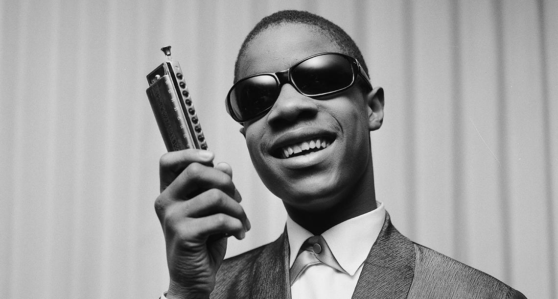 Stevie Wonder performing.