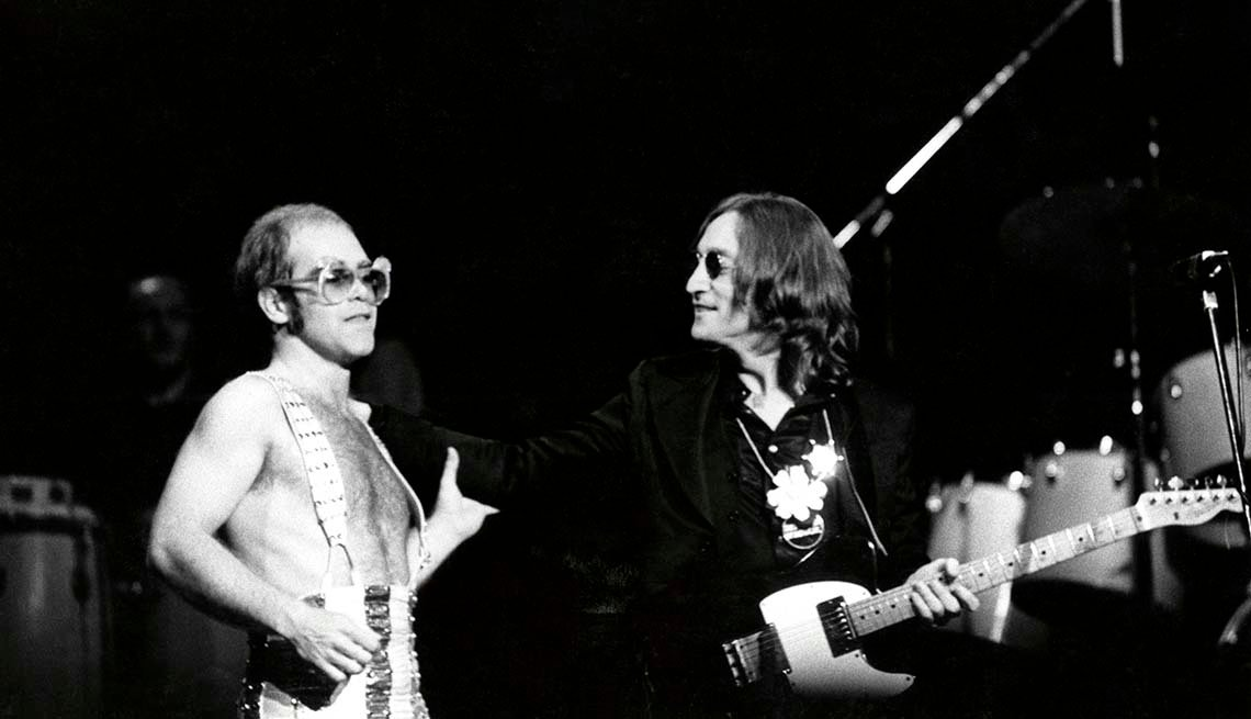 item 5 of Gallery image - John Lennon with Elton John performing live onstage at Madison Square Garden - Lennon's last live appearance.