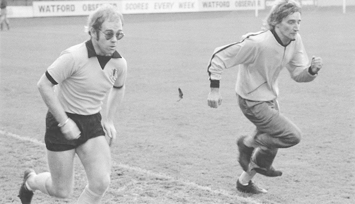 item 6 of Gallery image - British singers Elton John (left) Rod Stewart training at Watford Football Club, London, November 1973.