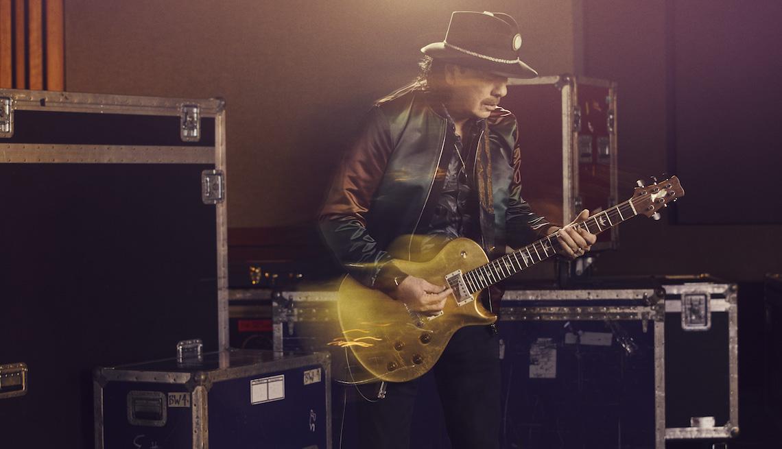 Carlos Santana playing a guitar