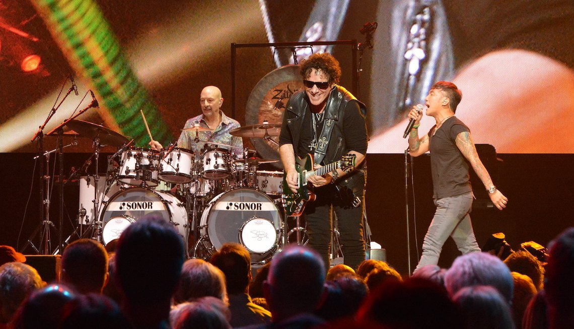 item 1, Gallery image. (L-R) Drummer Steve Smith, guitarist Neal Schon and vocalist Arnel Pineda of Journey perform during the first night of the band's second nine-show residency at The Joint inside The Hard Rock Hotel & Casino on May 3, 2017 in Las Vegas, Nevada.