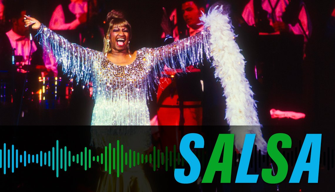 item 3 of Gallery image - Celia Cruz smiling with her arms raised onstage during a performance, with the label Salsa
