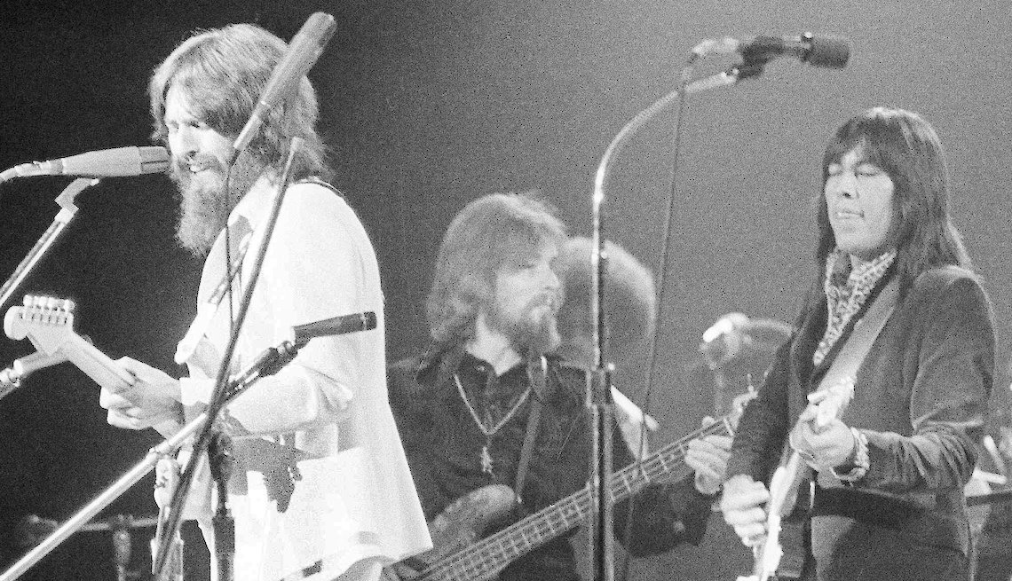 item 8, Gallery image. In this Aug. 1, 1971 file photo, Jesse Ed Davis, right, a guitarist of Kiowa and Comanche ancestry, performs with George Harrison, left, formerly of the Beatles, at the Concert For Bangladesh at Madison Square Garden in New York City.