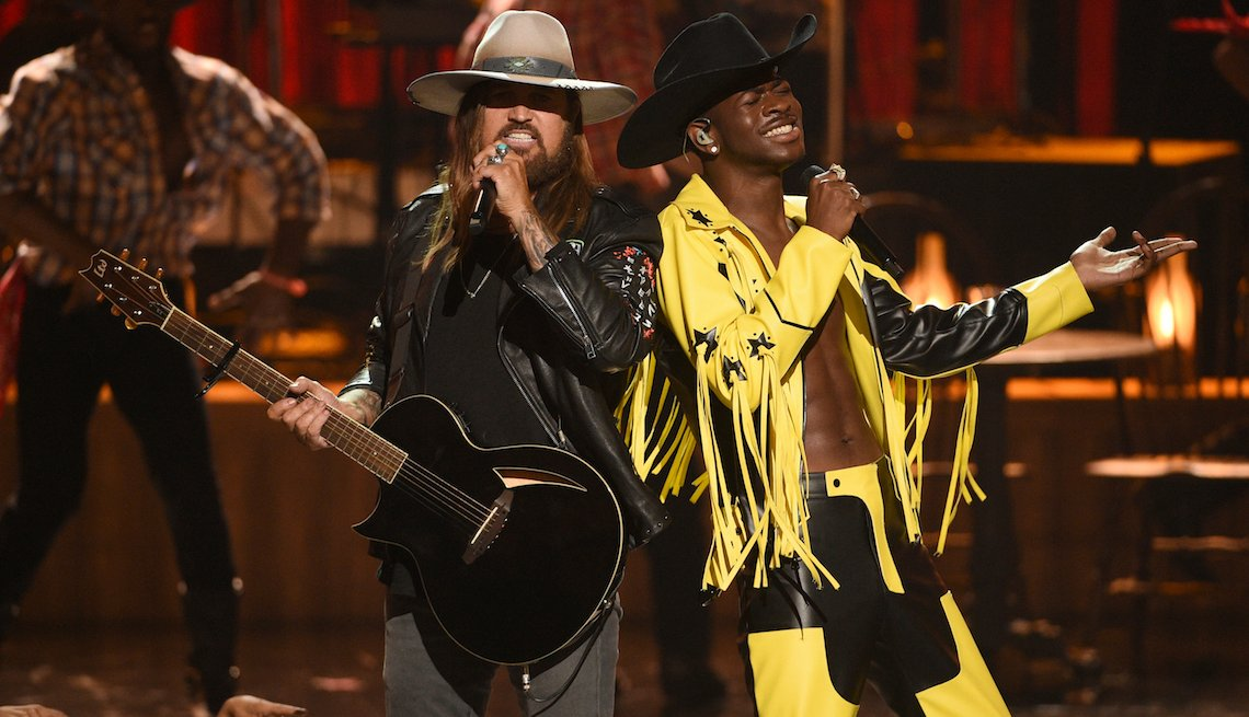 "item 19, Gallery image. Billy Ray Cyrus, left, and Lil Nas X perform ""Old Town Road"" at the BET Awards on Sunday, June 23, 2019, at the Microsoft Theater in Los Angeles."