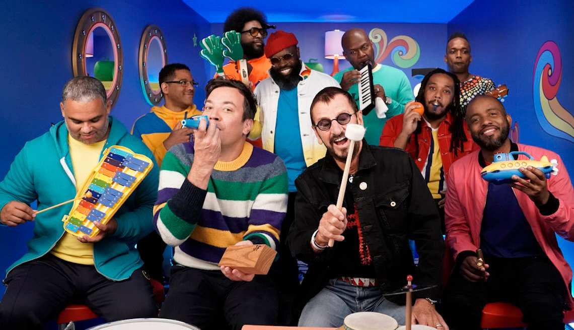 "item 16, Gallery image. (l-r) Host Jimmy Fallon and Ringo Starr during ""Yellow Submarine Classroom Instruments"" with The Roots on September 24, 2019"