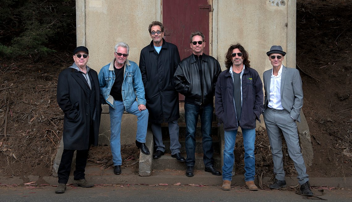 All of the members of Huey Lewis and the News standing together