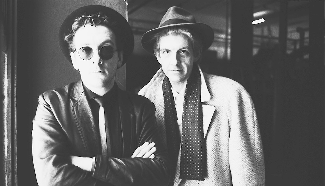 Singer songwriters Elvis Costello and Nick Lowe standing next to each other