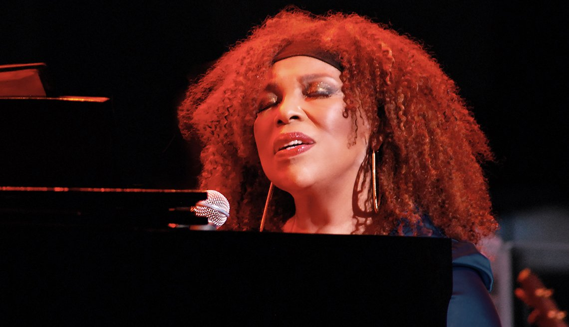 Roberta Flack singing while playing the piano