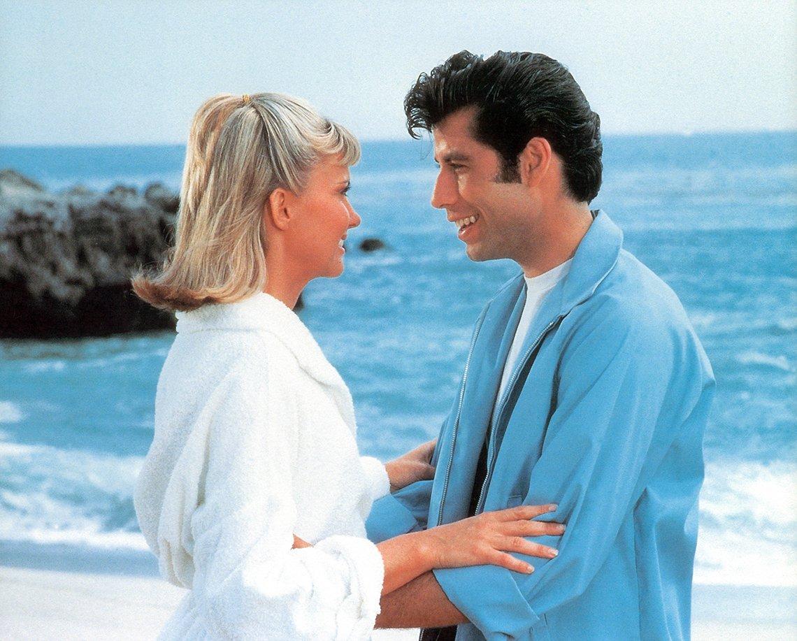 Olivia Newton John and John Travolta on the beach in the film Grease