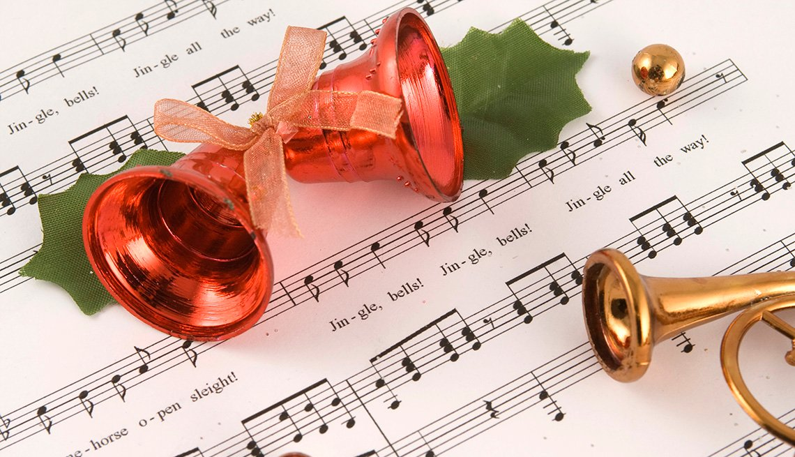 Bells on top of sheet music for the song Jingle Bells