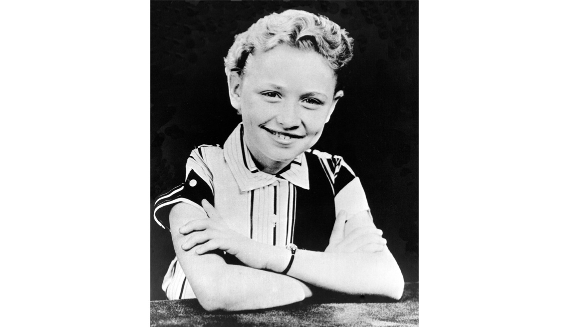 Dolly Parton poses for a portrait at age 9