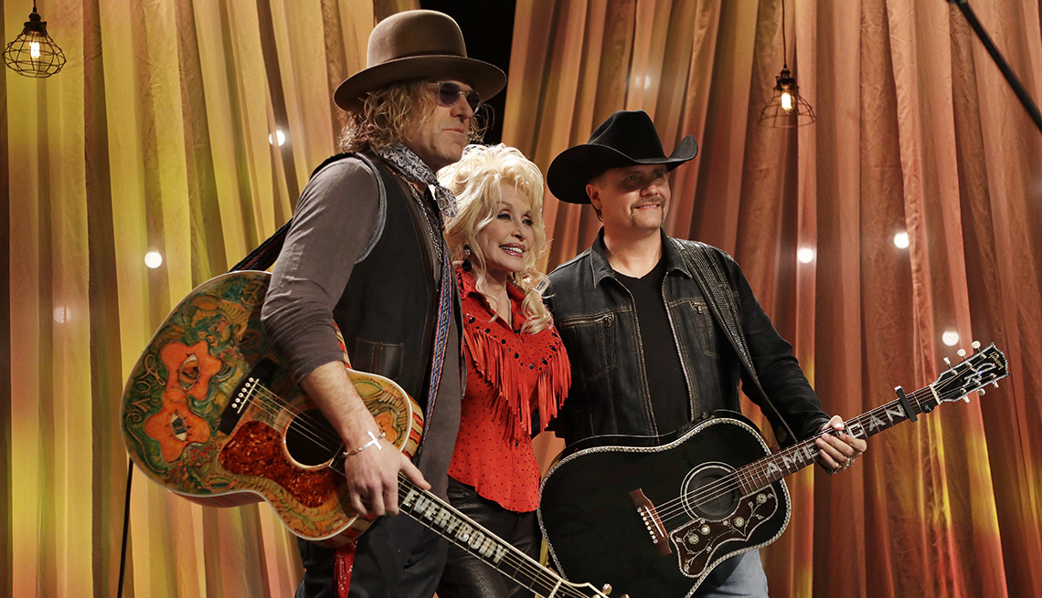 Dolly Parton with Kenny Alphin and John Rich of the country music duo Big and Rich