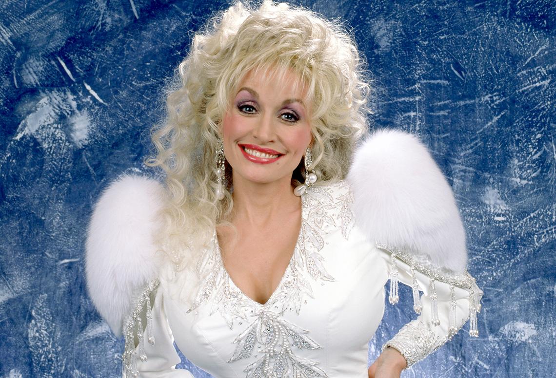 Dolly Parton poses for a studio portrait in 1992