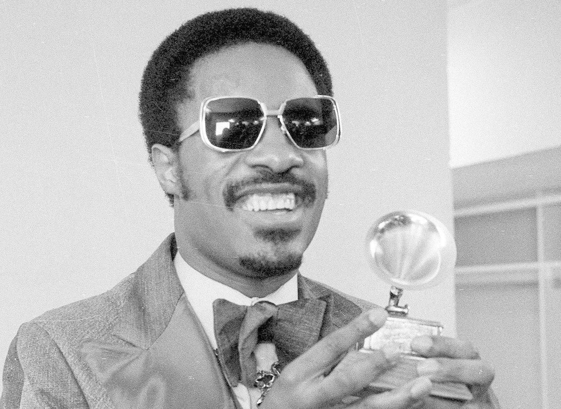 Stevie Wonder holds the trophy he received for Best Male Pop Vocalist at the 17th annual Grammy Awards