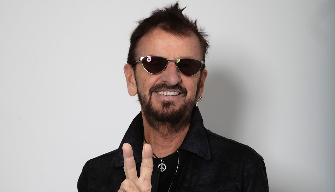 Musician Ringo Starr giving the peace sign