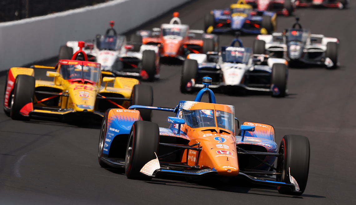 Race cars on the track during the 104th running of the Indianapolis 500