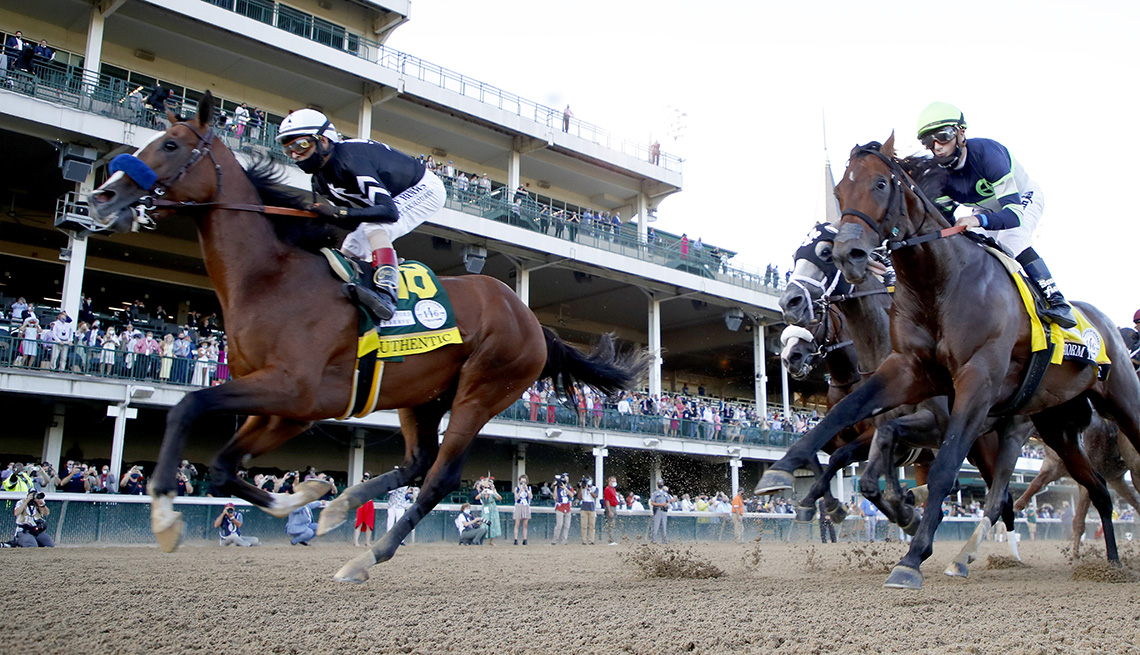 Horses racing on the track during the 146th running of the Kentucky Derby at Churchill Downs