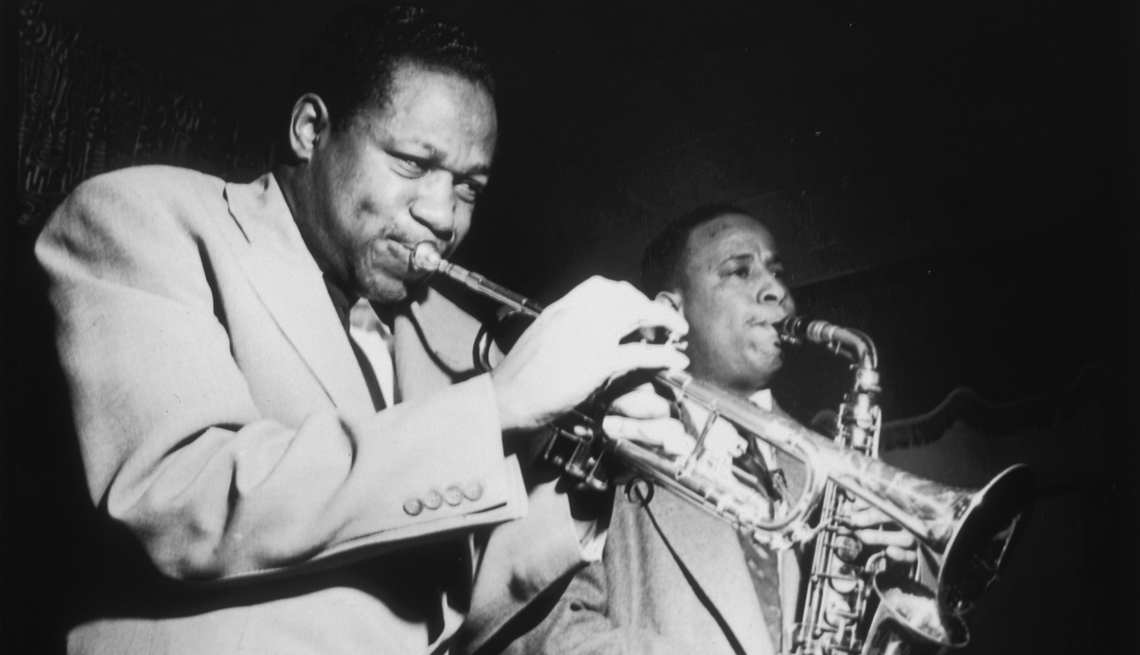 american jazz musicians clifford brown and lou donaldson performing on stage with a trumpet and an alto saxophone