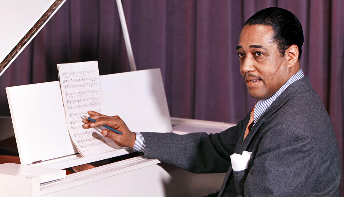 composer duke ellington performing at a piano