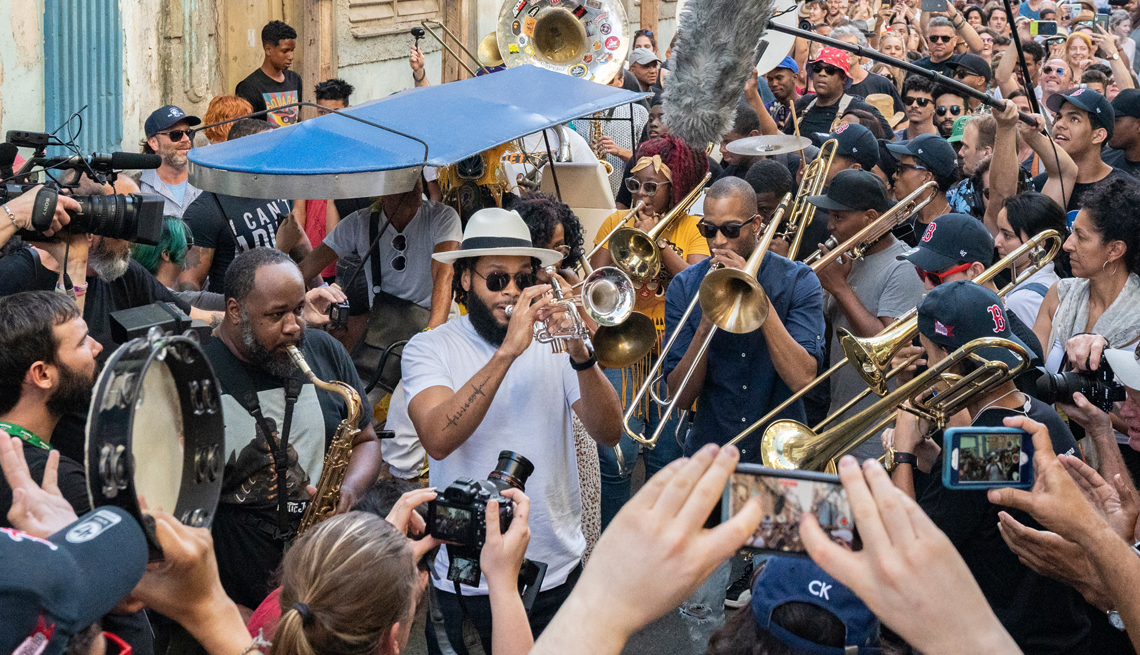 erion williams julian gosin and troy trombone shorty andrews in a conga line with cuban band cimafunk in havana cuba