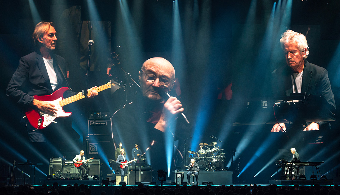 Genesis performs on stage for The Last Domino Tour
