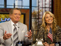 Regis Philbin and Kelly Ripa appear on set during the taping of Live! with Regis and Kelly