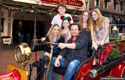 Michael J. Fox, his wife Tracy Pollan, and their kids pose at Disneyland