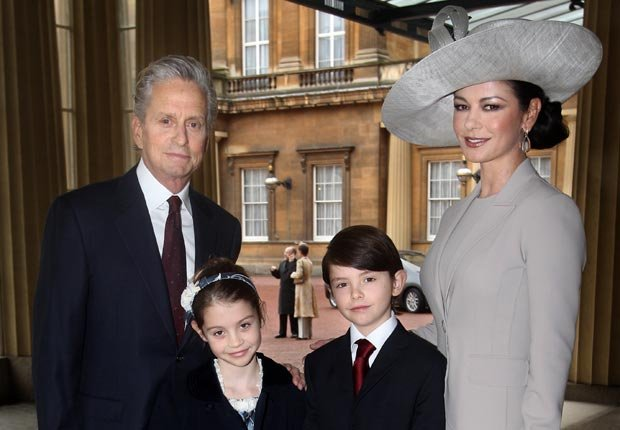Michael Douglas, wife Catherine Zeta-Jones, and their children Dylan and Carys (Lewis Whyld/AFP/Getty Images)