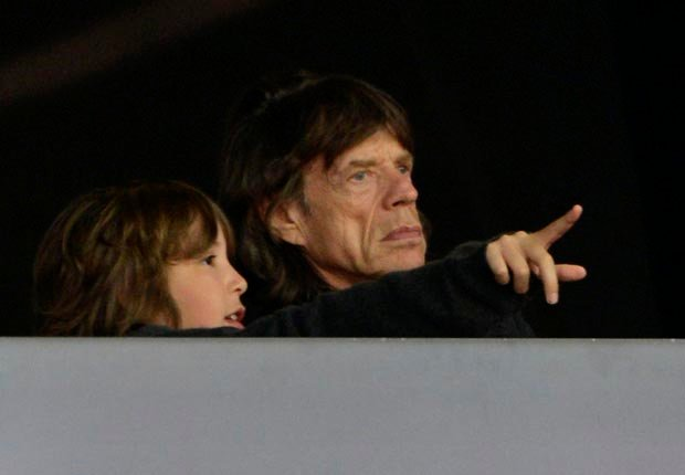 Mick Jagger with son Lucas (Sascha Schuermann/AP Images)