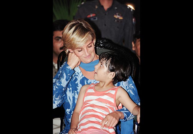 Princess Diana holds a young patient during a 1997 visit to Lahore, Pakistan. (Alamy)