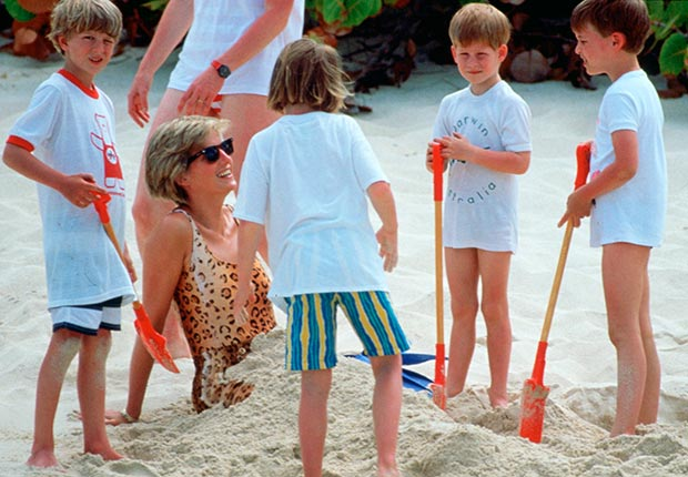 Princess Diana being buried in the sand by Prince William and Prince Harry during a 1990 vacation. (Tim Graham/Getty Images)