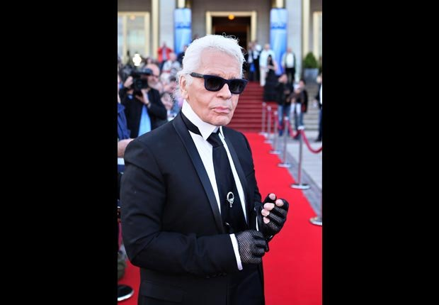 German fashion designer Karl Lagerfeld poses for photographers (Jan Woitas/DPA/Corbis)