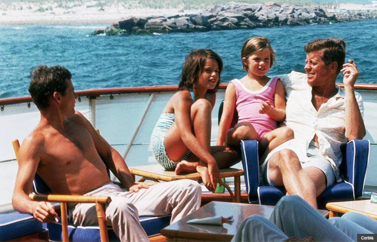 President Kennedy aboard the 'Honey Fitz' off Cape Cod, with niece Maria Shriver, and daughter, Caroline. (Corbis)