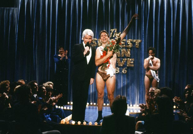 Harmon poked fun at his recent Sexiest Man Alive title on Saturday Night Live in a skit on May 9, 1987 with Phil Hartman and Jon Lovitz. For Mark Harmon Through the Years slideshow.