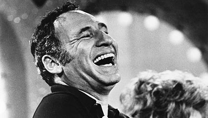 Director Mel Brooks laughs on stage, Mel Brooks Strikes Back, AARP interview